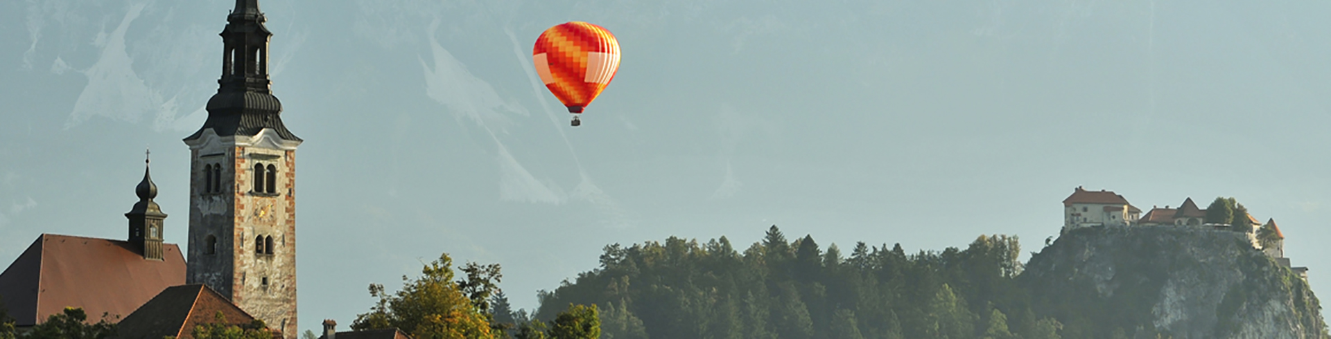 Hot air ballooning over Lake Bled and castle